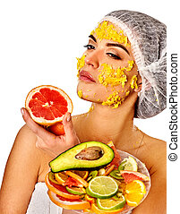 Facial mask from fruits for woman. Girl in medical hat. -...