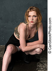Woman in sequins and black - Pretty strawberry blonde woman...
