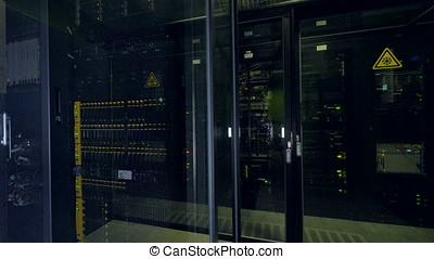 Closed glass doors into a data center room. - Blocked glass...