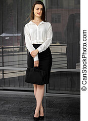 beautiful young Office women in a white shirt and skirt...