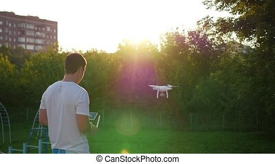 The operator remotely controls the drone. The flight of the drone
