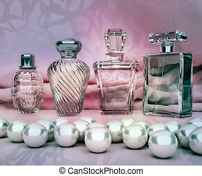 Perfume in a glass bottles and pearl on pink background.