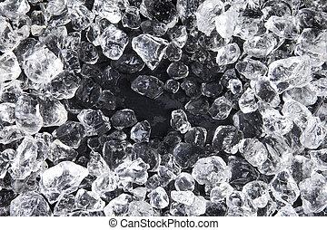 Crushed ice on black background