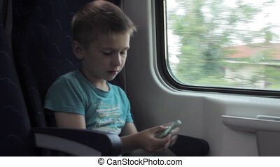 Boy showing skills by flicking fidget spinners with finger...
