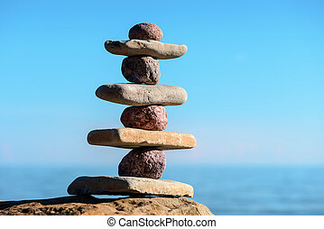 Stack on the coast - Balancing of pebbles on the coast