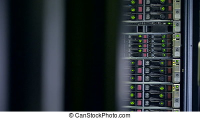 A server cabinet filled full with hard disks. - A black...