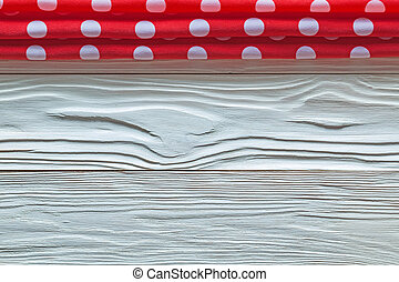 Red table cloth on wooden board