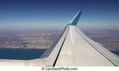 Plane is flying along the sea coast after takeoff -...