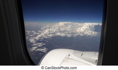 Flying over the clouds in a plane aircraft - Flying in a...