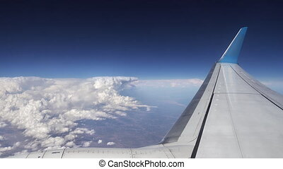 Flying over the clouds. View from plane aircraft. - Flying...