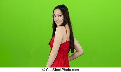 Girl posing for cameras, this is her work. Green screen....