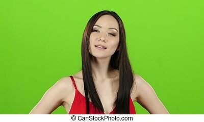 Asian girl posing in camera and she smiling. Green screen....