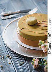 Bakery with piece of unusual yellow mousse cake with almond...