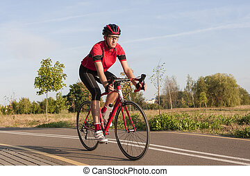 Sport and Cycling Concepts and Ideas. Male Caucasian Road...