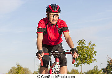 Cycling Concepts and Ideas. Smiling Caucasian Road Cyclist...