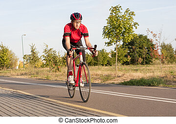 Sport and Cycling Concepts. Professional Male Cyclist in...