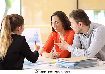 Partners checking a growth graph at office - Three partners...