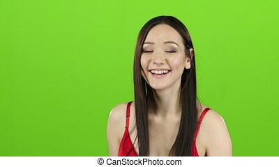 Girl in the spacious room is having fun and showing a thumbs up. Green screen. Slow motion
