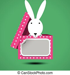 Rabbit sits in box for gift with sticker for your text