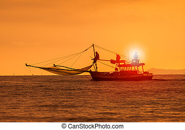 silhouette photography of fishery boat and sunset sky over...
