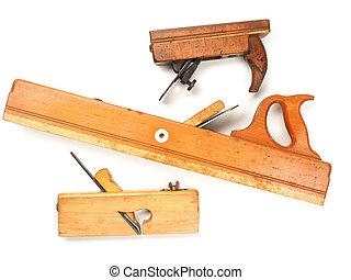 Old used wood plane on white - Three old used wood plane on...
