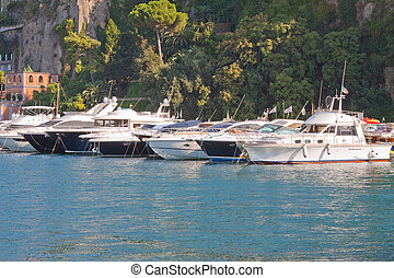 Big Boys Toys - A row of anchored motor launches in Sorrento...