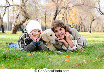Mother and son together having fun in the autumn park...