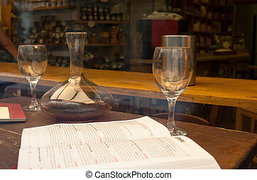 Wine book, glasses and decanter on the table
