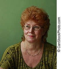 Red-haired middle-aged woman wearing glasses