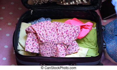 A happy young woman is going to rest on a trip
