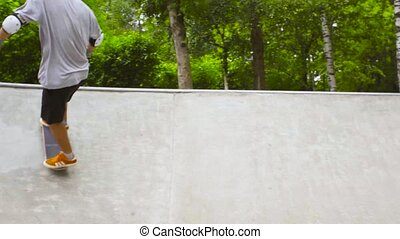 Young man skateboarding at outdoor skate park - Slow motion...