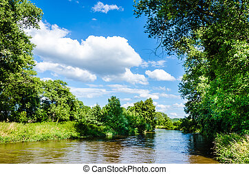 Awesome landscape with river and summer blue sky