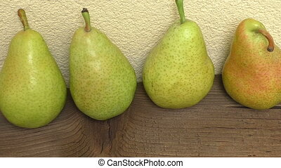 Fresh organic pears on wooden plank. Pears on wooden table.