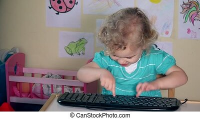 wicked child girl typing computer keyboard. 4K