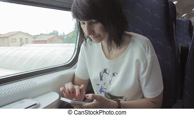 Woman Using Smart Phone in a Train