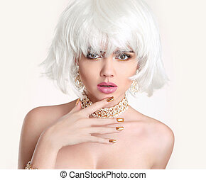 Beauty Blonde. Blond bob hairstyle. Fashion girl model with makeup, short hair, manicured nails