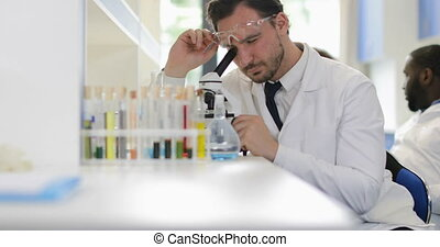 Man Scientist Working With Microscope In Laboratory Study...