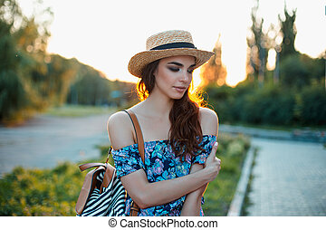 Attractive young woman enjoying her time outside in park...