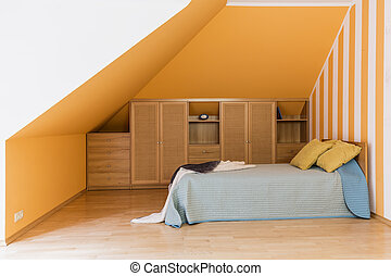 Modest bedroom at the attic