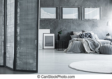 Gray bedroom with room divider