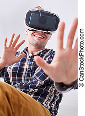 Smiling man with VR glasses