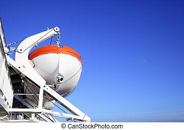 Life-boats on a cruise ship. Copyspace composition
