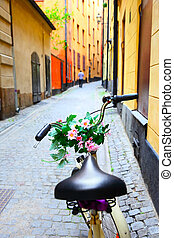 Bicycle with flowers on handle bar in Stockholm - Bicycle...