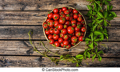 Tomatoes rustic - A pottery bowl filled with sunriped...