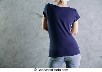 Apparel concept - Back view of young woman wearing blank...