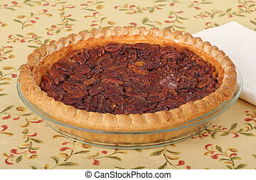 Pecan Pie - Baked whole pecan pie dessert in a pie plate