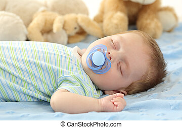 Baby sleeping with a pacifier - Cute baby sleeping with a...
