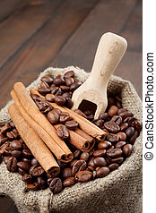 sack with coffee beans and cinnamon, wooden scoop