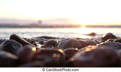 Close up view on stones on sea shore.