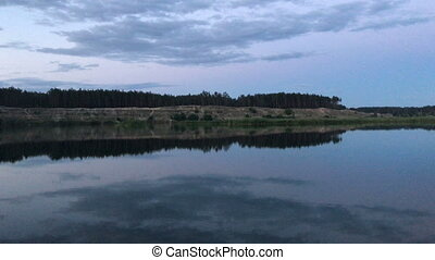 evening Lake with reflection of the sky in the water -...